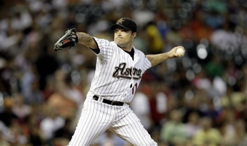 Houston Astros pitcher Mike Hampton throws a pitch against the Pittsburgh Pirates during the fifth inning of a baseball game Monday, July 6, 2009 in Houston. (AP Photo/David J. Phillip)