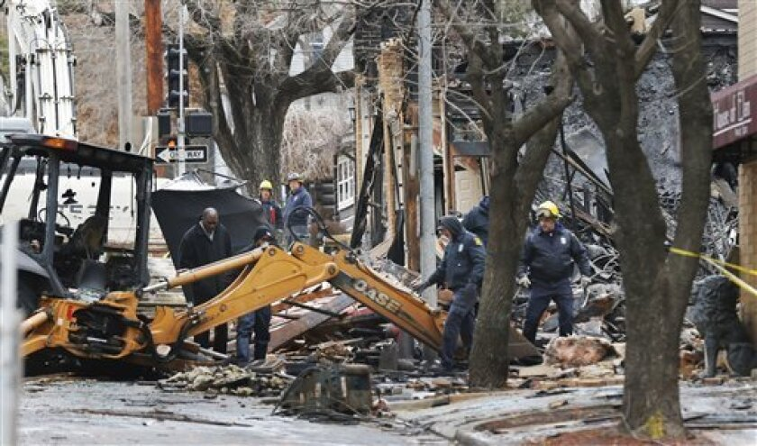 Officials inspect a burned out  JJ's Restaurant at the Plaza shopping district of Kansas City, Mo., Wednesday, Feb. 20, 2013.  Search crews at the site of the massive explosion that destroyed the restaurant,  recovered one body Wednesday, and the city's mayor said there was no certainty the rubble