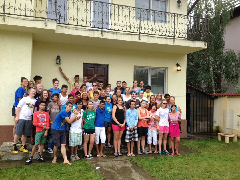 Romanian children and Heart To Heart International Ministries team members gather at camp.