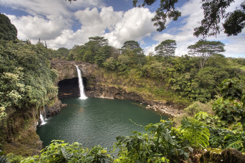 Hawaii can be expensive, but there are plenty of ways to economize. Much of the islands' natural beauty can be seen for free or a small entrance fee. Rainbow Falls is just outside Hilo on Hawaii Island.