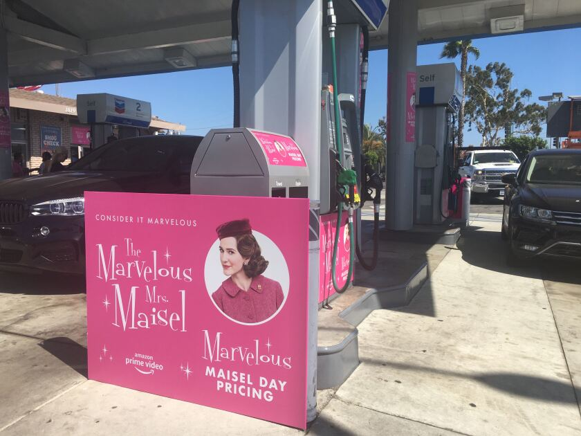"A ""Maisel Day"" promo poster at a Chevron in Santa Monica."