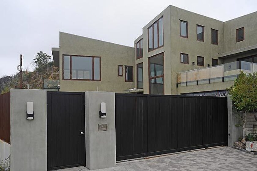 Pop star Rihanna has listed her water-damaged Beverly Hills Post Office-area home at $4.5 million.