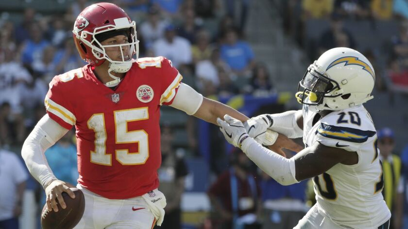 CARSON, CA, SUNDAY, SEPTEMBER 9, 2018 - Chiefs quarterback slips the tackle of Chargers cornerback D