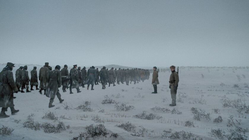 """A scene of many men in gray coats walking in the snow from the movie """"About Endlessness."""""""