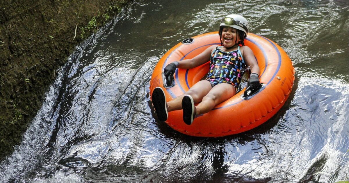 Kauai with kids is one giant theme park, but it's no Disneyland. It's better