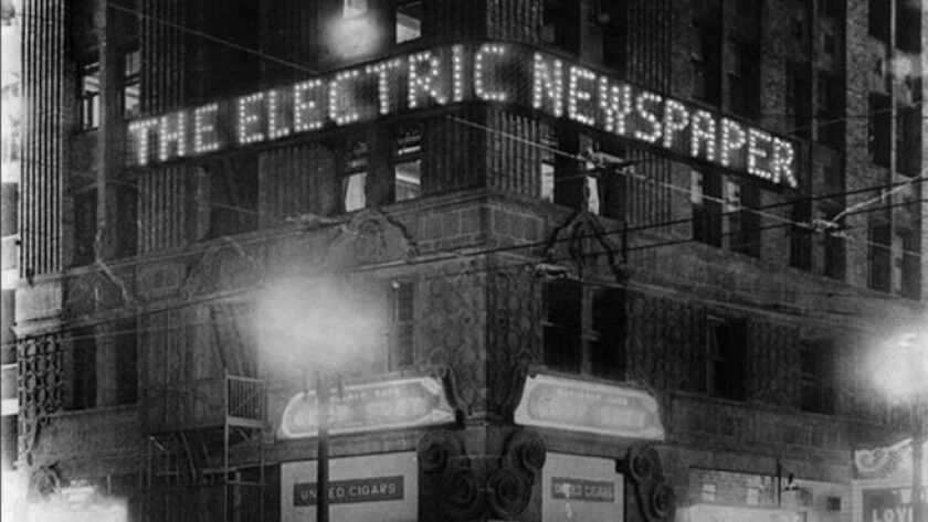 Oct. 1931: The Times-Richfield Electric Newspaper lit up during preview at the corner of Sixth and H