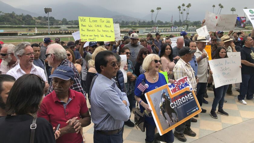 FILE - In this Friday, June 20, 2019, file photo, Santa Anita Park workers hold a rally at the track