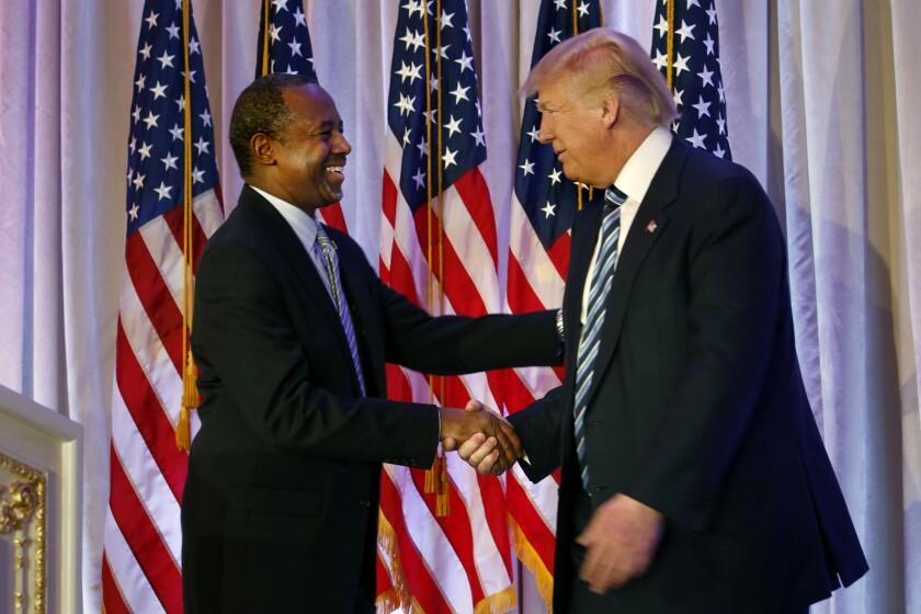 Ben Carson, left, endorses Republican presidential front-runner Donald Trump in Florida on Friday.
