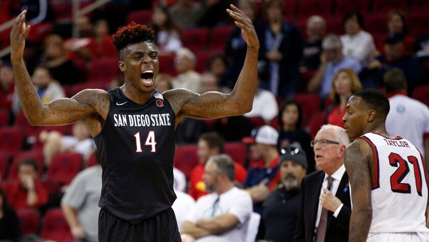 SDSU's Zylan Cheatham reacts after making two free throws with 22 seconds left in the Aztecs' 70-67 win at Fresno State on Saturday.