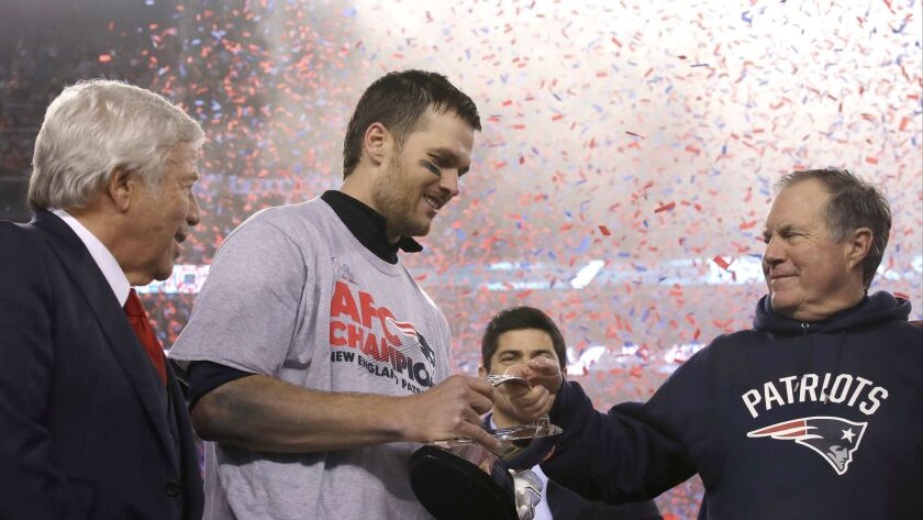 New England Patriots owner Robert Kraft, left, quarterback Tom Brady and coach Bill Belichick celebrate after a win over the Pittsburgh Steelers in the AFC championship game on Jan. 22, 2017.