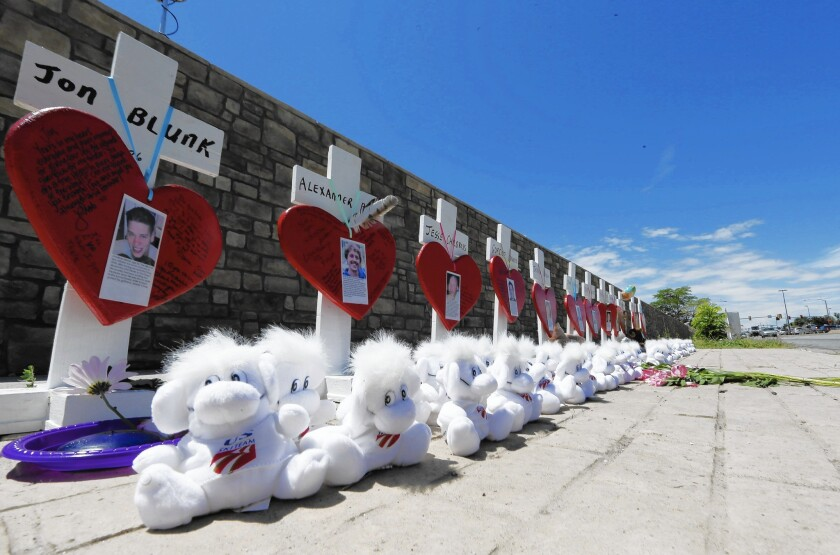Crosses stand along a street in Aurora, Colo., on July 20 to honor victims of the 2012 theater massacre and to mark its third anniversary. The penalty phase of the James E. Holmes trial begins July 22.