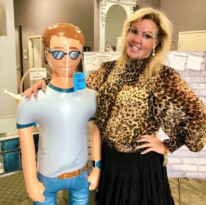 TV dance judge Mary Murphy with inflatable figure wearing a face shield