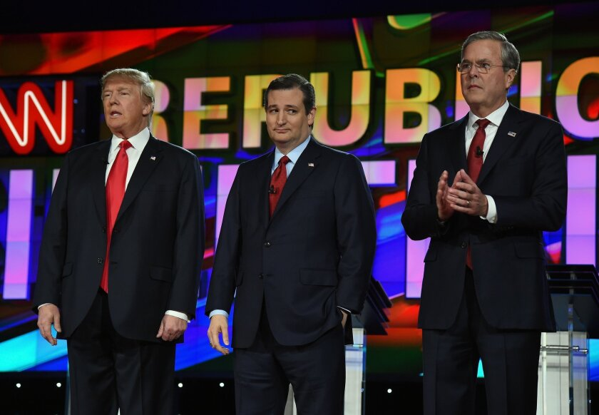Republican presidential candidates Donald Trump, from left, Texas Sen. Ted Cruz and Jeb Bush stand on stage during the CNN debate in Las Vegas on Tuesday.