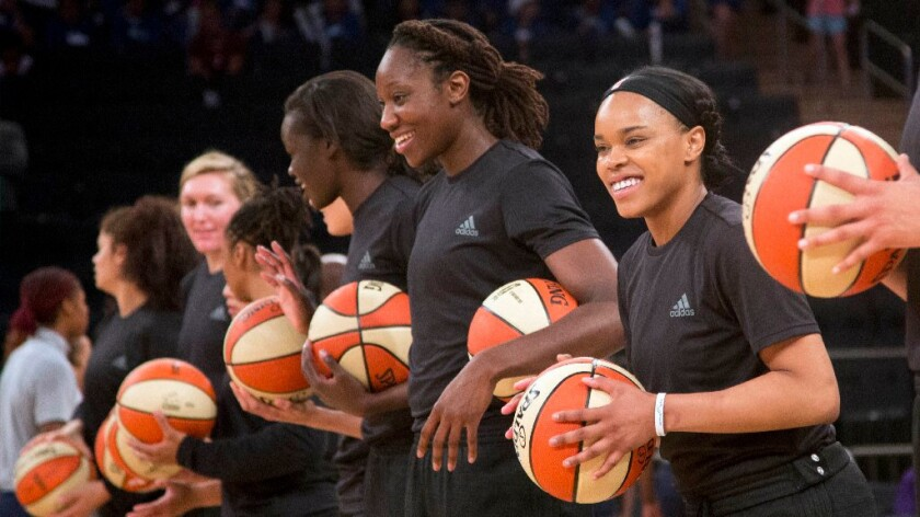 Members of the New York Liberty wear black warmup jerseys before the start of a game on July 13.