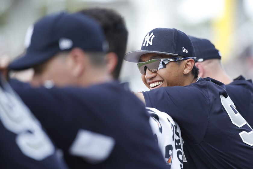 Gosuke Katoh of the New York Yankees watches from the dugout during spring training game in 2019 in Fort Myers, Fla.