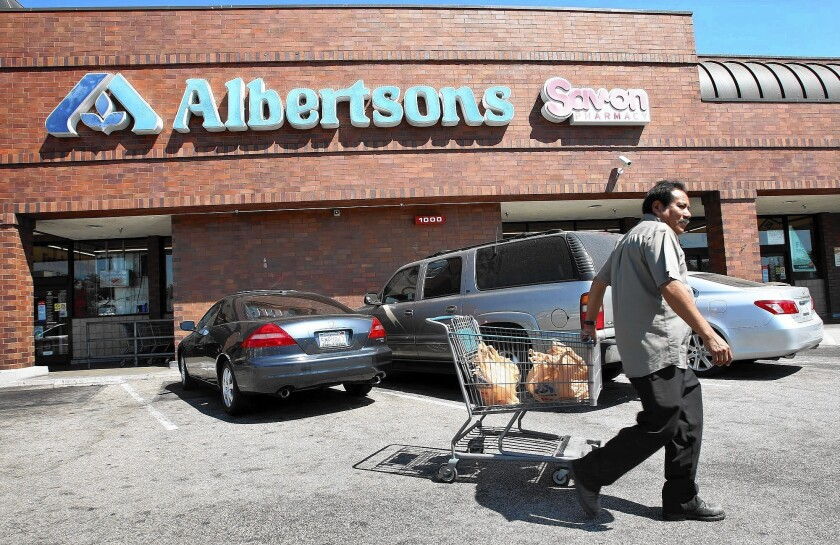 A customer walks by an Albertsons store on Sept. 6, 2012.