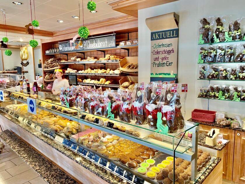 Bohnenblust bakery in Bern, Switzerland, displays chocolate Easter bunnies wearing face masks on its display shelf.