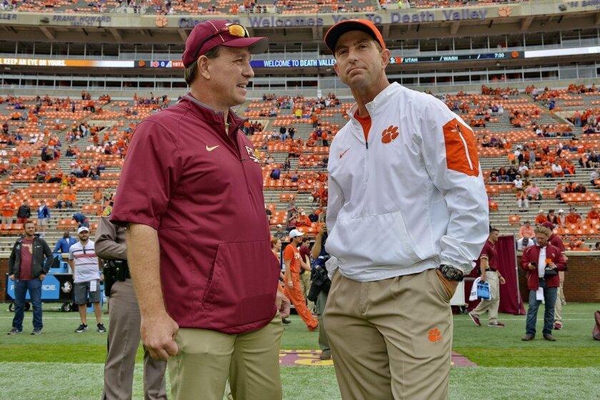 Florida State head coach Jimbo Fisher, left, and Clemson head coach Dabo Swinney talk before the start of an NCAA college football game Saturday, Nov. 7, 2015,  in Clemson,  S.C.  (AP Photo/Richard Shiro)