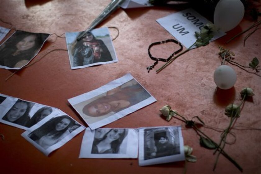 A makeshift memorial that include pictures of the victims of the Kiss nightclub fatal fire is seen inside the gymnasium where a collective funeral was held a day earlier, in Santa Maria, Brazil, Tuesday, Jan. 29, 2013. A fast-moving fire roared through the crowded, windowless nightclub, early Sunda