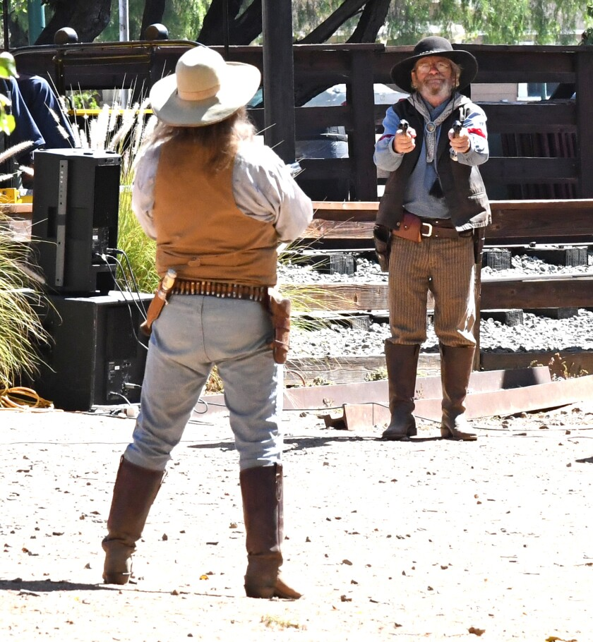 Reenactors stage a robbery near the Poway Midland Railroad tracks during a previous Rendezvous.