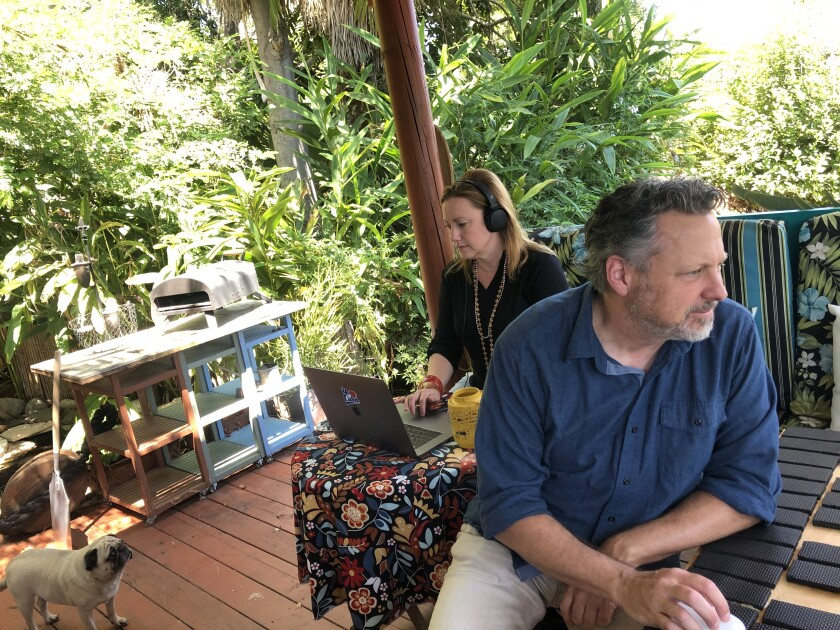 Matthew Armstrong and Courtney Corey work from home in their Escondido backyard hut.