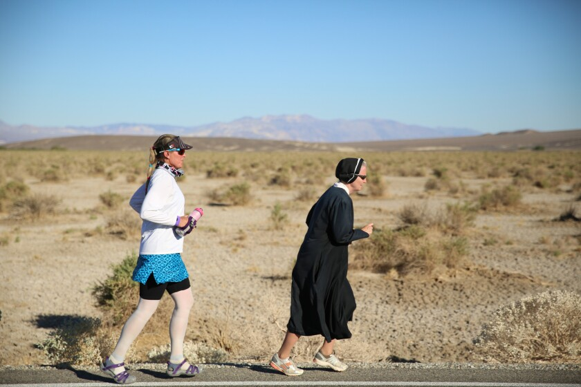 Lisa Smith-Batchen, left, runs with Sister Mary Beth Lloyd, her charity advisor and pace runner.