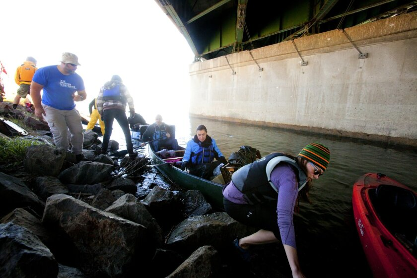 Volunteers used more than three dozen kayaks to help clean the river from 3,000 pounds of trash and nearly 200 pounds of recyclable glass and plastic during 5th annual San Diego River Estuary cleanup in 2016.