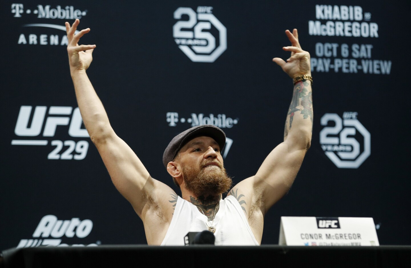 Conor McGregor raises his arms during a news conference for the UFC 229 mixed martial arts bouts Thursday, Oct. 4, 2018, in Las Vegas. McGregor is scheduled to fight Khabib Nurmagomedov on Saturday in Las Vegas. (AP Photo/John Locher)