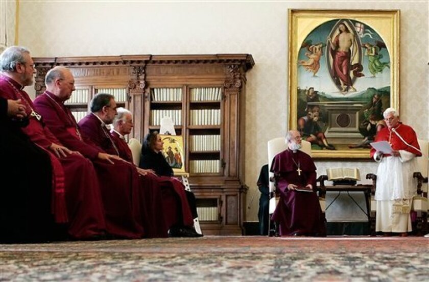 """FILE - In this Nov. 23, 2006 file photo, Pope Benedict XVI delivers his speech as Archbishop of Canterbury Rowan Williams, seated at his right, and a delegation of Anglican Bishops listen, during their meeting at the Vatican. Five Church of England bishops announced Monday, Nov. 8, 2010 they are converting to Catholicism following an invitation to disaffected Anglicans from Pope Benedict XVI - the highest-profile defectors among conservatives opposed to gay bishops and female clergy. The Catholic Bishops' Conference of England and Wales said Bishop of Ebbsfleet Andrew Burnham, Bishop of Richborough Keith Newton, Bishop of Fulham John Broadhurst - as well as retired bishops Edwin Barnes and David Silk - have decided """"to enter into full communion with the Catholic Church.""""(AP Photo/Alessandro Bianchi, Pool, file)"""