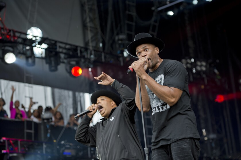 "Joseph ""Run"" Simmons, left, and Darryl ""DMC"" McDaniels perform in 2012. Run-DMC filed a $50-million lawsuit Thursday accusing Wal-Mart, Amazon, Jet and other retailers of selling products that traded on the group's name without permission."