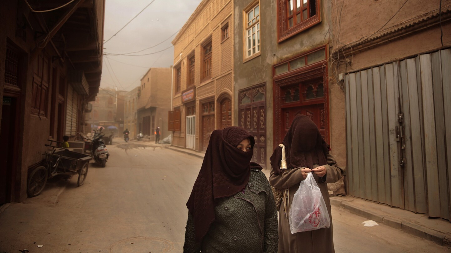 Muslim women in Kashgar, China. Women in the far northwestern city are allowed to cover their heads but not their faces. Kashgar is considered the heartland of the Uighurs, an ethnic Muslim group.