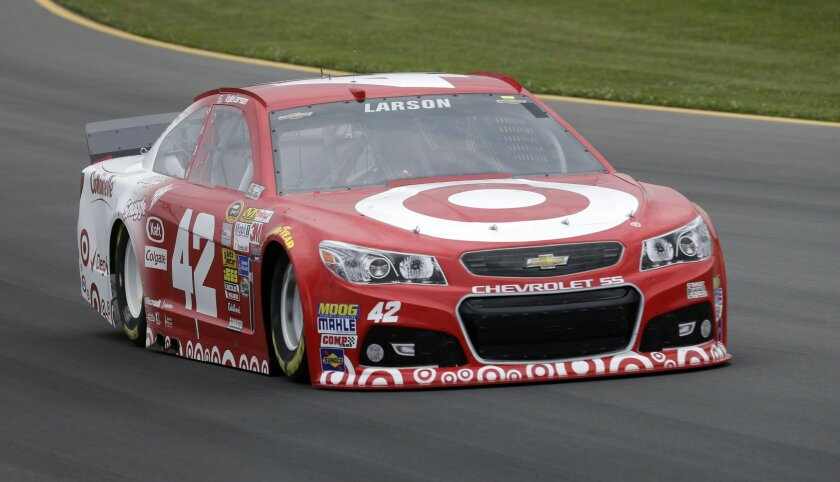 Kyle Larson drives during qualifying for Sunday's NASCAR Sprint Cup Series auto race at Pocono Raceway, Friday, Aug. 1, 2014, Long Pond, Pa. Larson qualified on the pole. (AP Photo/Mel Evans)