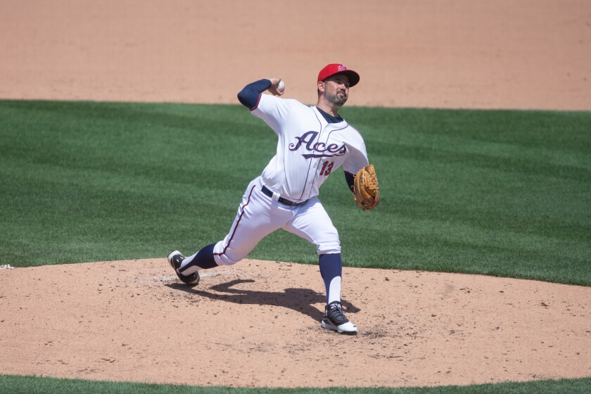 Reno Aces pitcher Zach Lee winds up for a pitch.
