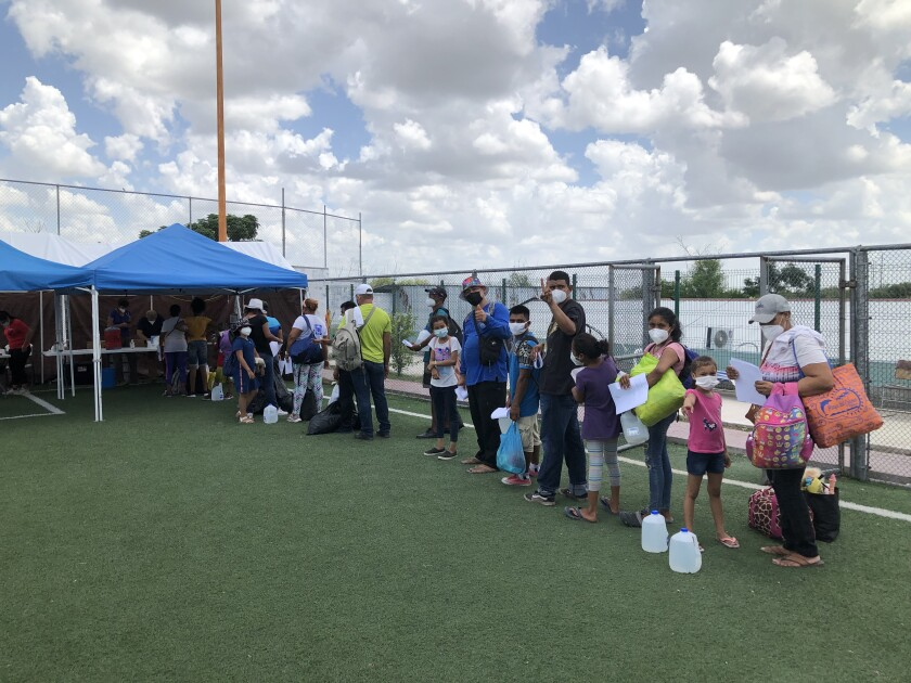 People wait in line outside a shelter in Reynosa, Mexico.