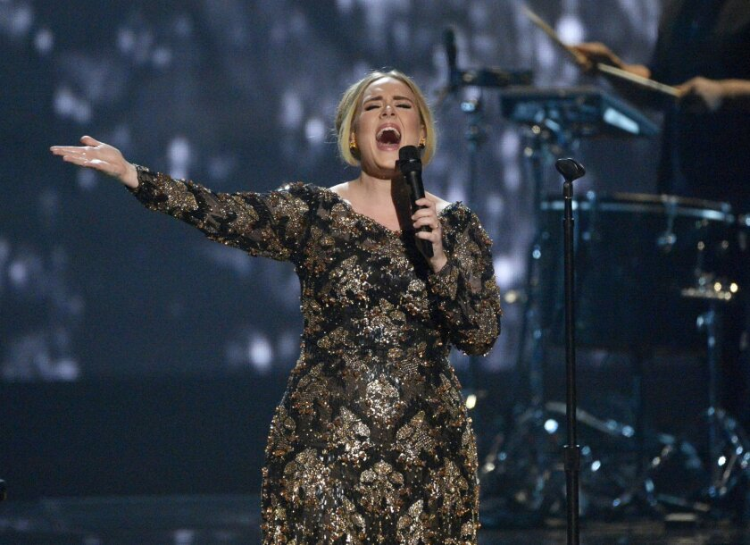 """In this image released by NBC, Adele performs at Radio City Music Hall in New York. The concert, """"Adele Live in New York City,"""" was televised on NBC on Monday, Dec. 14. Adele debuted her long-awaited album, """"25,"""" and it sold a whopping five million copies in just three weeks of release. (Virginia Sherwood/NBC via AP)"""
