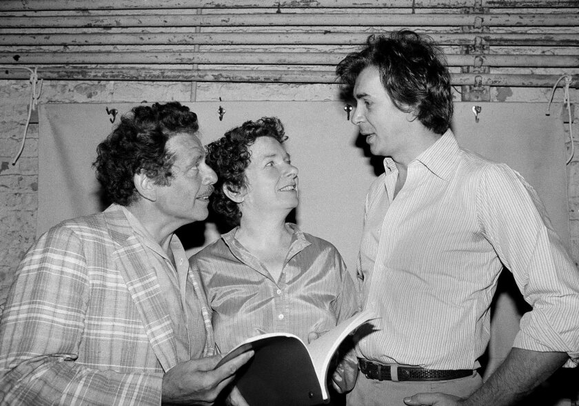 """FILE- In this Aug. 18, 1980, file photo, actor Frank Langella, right, talks with Jerry Stiller, left, and Angela Paton at the Morosco Theater in New York. Paton, best known for appearing with Bill Murray in """"Groundhog Day,"""" has died at age 86. Her nephew George Woolf says Paton died Thursday, May 26, 2016. (AP Photo/Marty Lederhandler, File)"""
