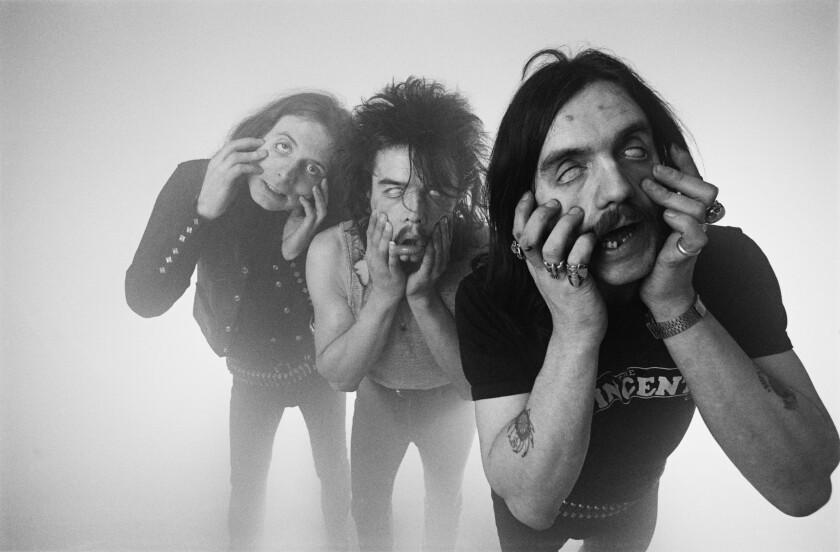 "Motorhead guitarist known as ""Fast Eddie"" Clarke, left, died Wednesday. He was 67."