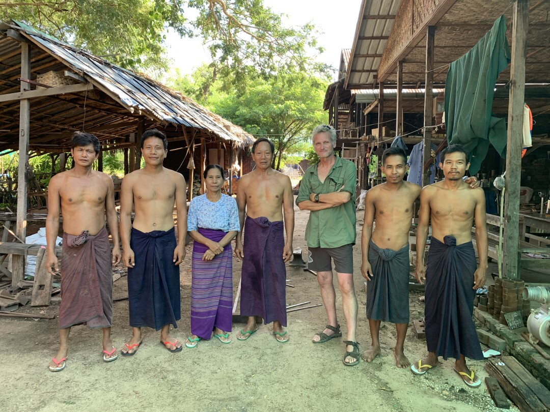Paul Salopek with a family of oxcart makers in northern Myanmar.