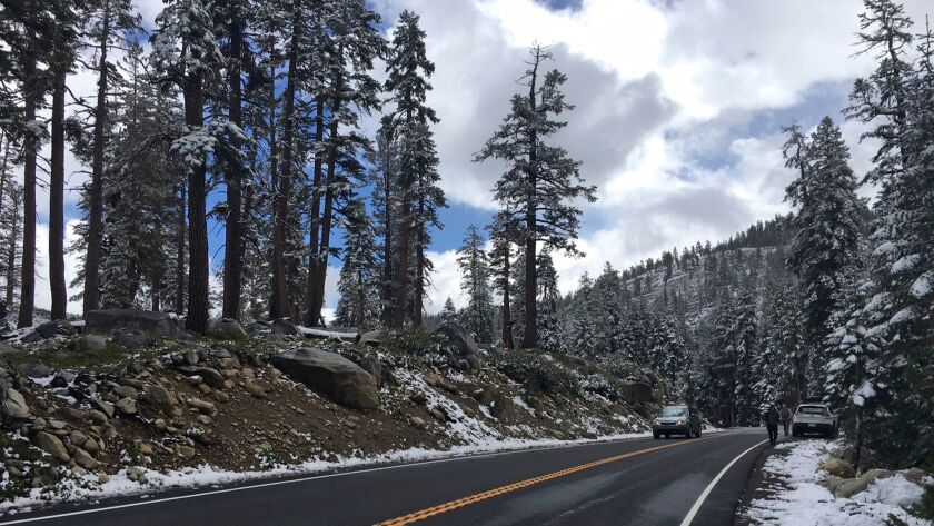 Tioga Road in Yosemite National Park last month after the first snow of the season. The road will be closed ahead of storms expected to dump up to two feet of snow in the Sierra Nevada, park officials said.