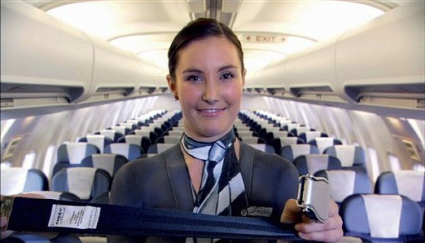 """In this undated photo supplied by Air New Zealand Friday, July 3, 2009, its staff is seen with body paint on in the airlines latest safety video call the """"Bare Essentials of Safety."""" The video shows three cabin staff and the pilot, all in uniform-colored full body paint, talking viewers through the aircraft's safety procedures. New Zealand's national airline has adopted the cheeky way to encourage passengers to watch its in-flight safety video: The cabin crew's uniforms are nothing but body paint. (AP Photo/Air New Zealand, HO)"""