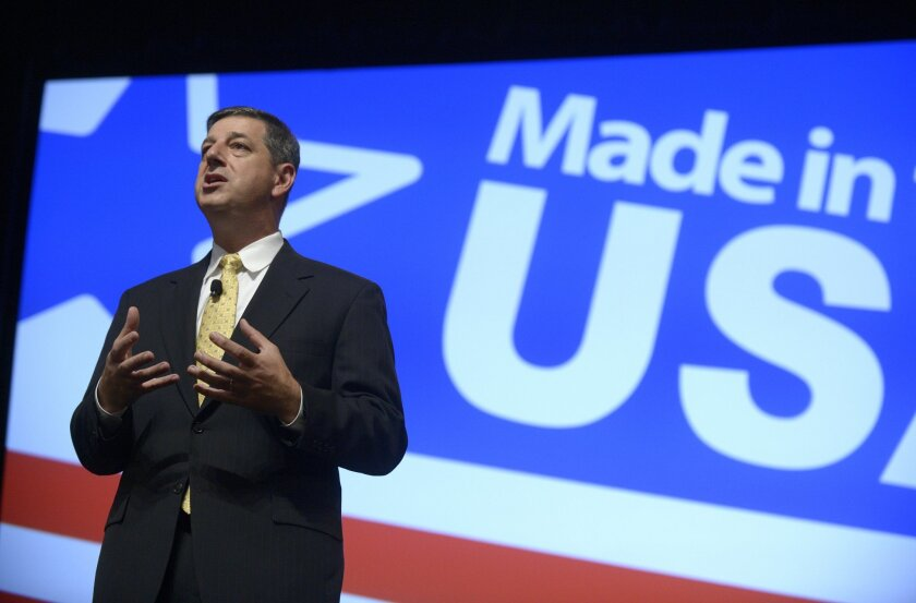 FILE - In this Aug. 22, 2013 file photo, Wal-Mart U.S. President and CEO Bill Simon addresses attendees of the Wal-Mart U.S. Manufacturing Summit in Orlando, Fla. Wal-Mart on Thursday, July 24, 2014 announced it is replacing Simon with Wal-Mart Asia CEO Greg Foran in what could be an indication tha