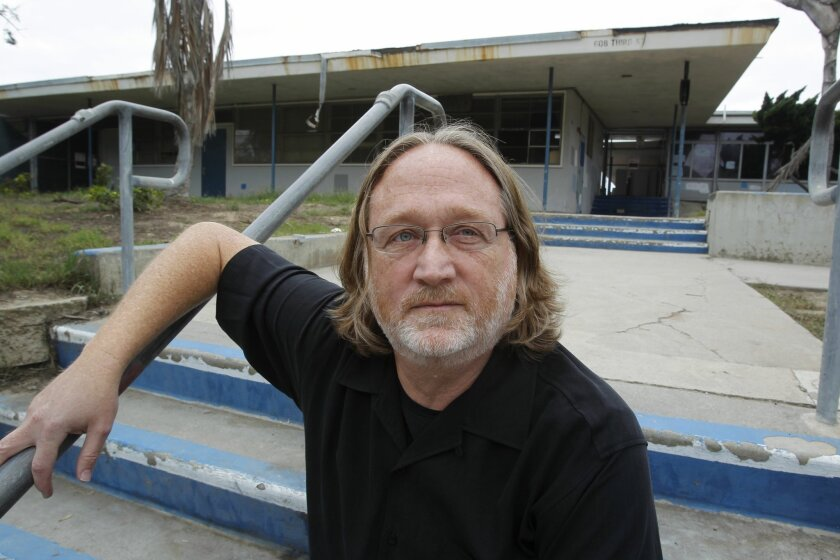 Encinitas resident Scott Chatfield, seen in front of the Pacific View School site, led a community campaign to try to stop the planned auction of the property.