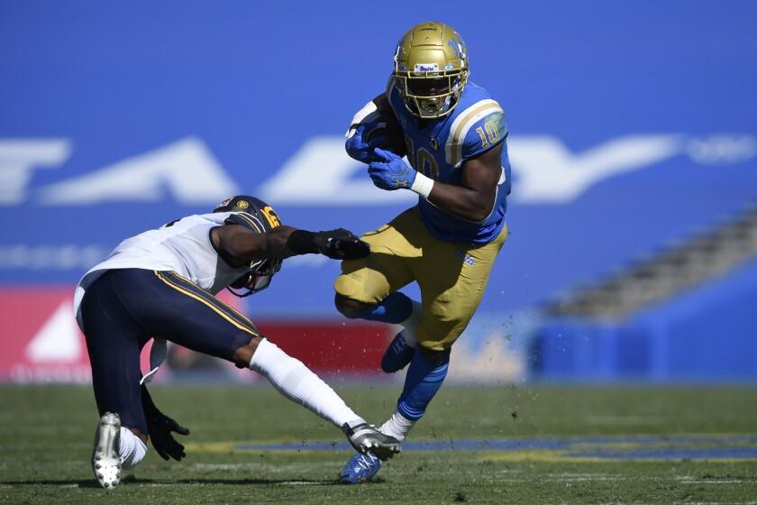 UCLA running back Demetric Felton runs past California safety Elijah Hicks on Sunday at the Rose Bowl.