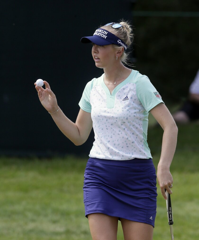 Jessica Korda acknowledges the fans after saving par on the ninth green during the third round of the LPGA Volvik Championship golf tournament at the Travis Pointe Country Club, Saturday, May 28, 2016, in Ann Arbor, Mich. (AP Photo/Carlos Osorio)