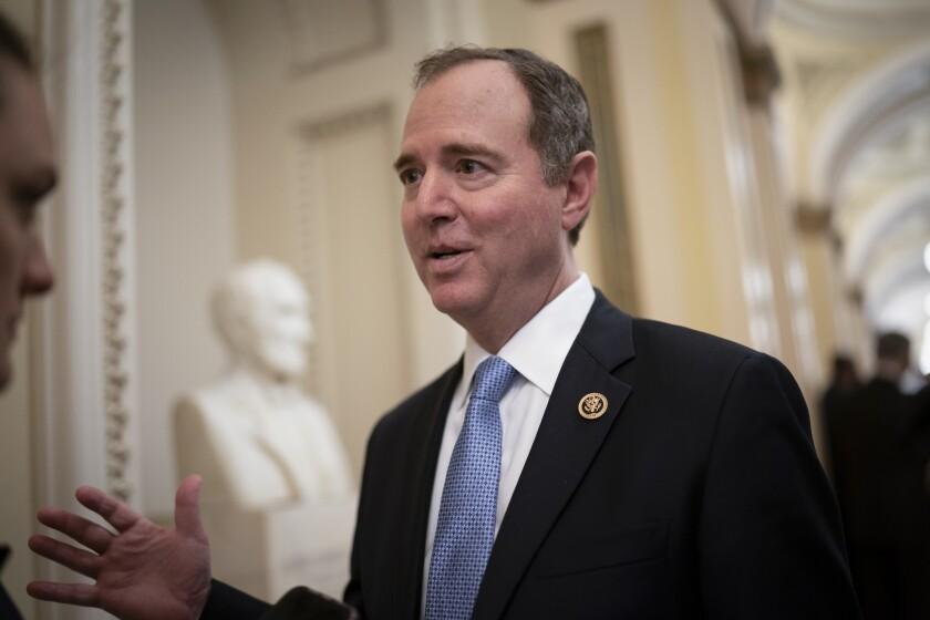Adam Schiff speaks in a Capitol hallway.