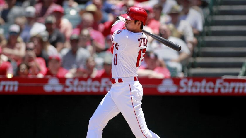 The Angels' Shohei Ohtani hits a single in the second inning against the Texas Rangers at Angel Stadium on June 3.