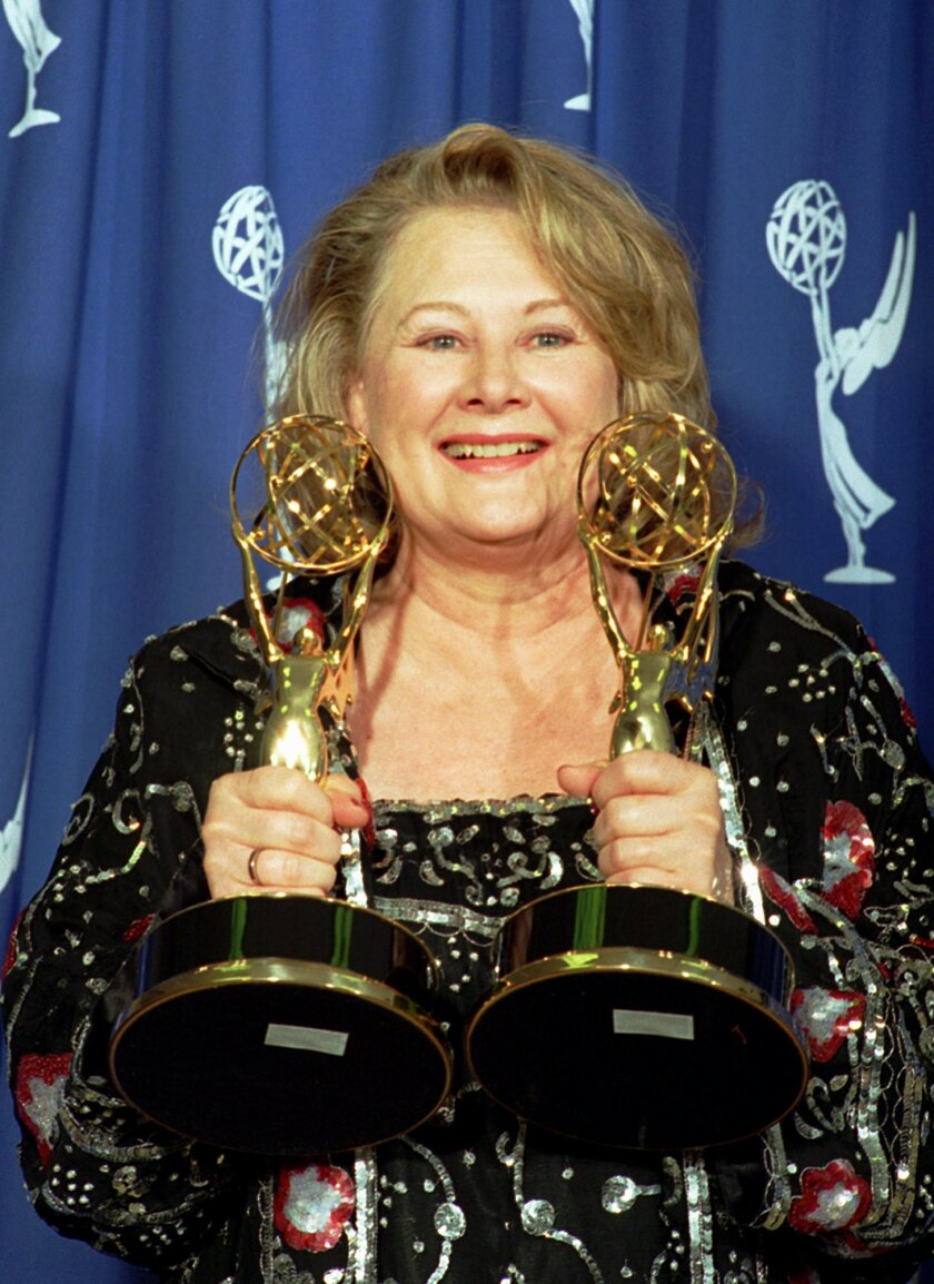 Shirley Knight holds two Emmy awards she won at the 1995 Emmy Awards at the Pasadena Civic Auditorium.