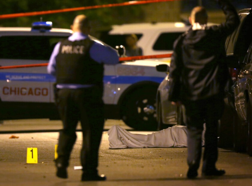 Chicago police work the scene where a man was fatally shot in the chest in the Washington Park neighborhood on May 30. Violent crimes are on the rise in many major U.S. cities so far this year.