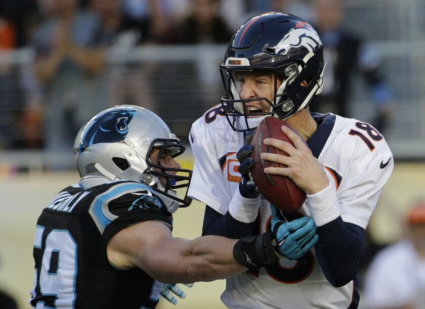 Denver Broncos' Peyton Manning, right, is sacked by Carolina Panthers' Luke Kuechly (59) during the first half of the NFL Super Bowl 50 football game Sunday, Feb. 7, 2016, in Santa Clara, Calif.  (AP Photo/Julio Cortez)
