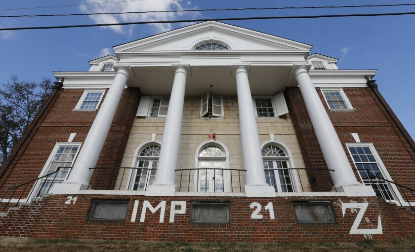 FILE - This Nov. 24, 2014, file photo, shows the Phi Kappa Psi house at the University of Virginia in Charlottesville, Va. Three University of Virginia graduates and members of the fraternity profiled in a debunked account of a gang rape in a retracted Rolling Stone magazine story filed a lawsuit against the publication and the article's author Wednesday,July 29, 2015, court records show. . (AP Photo/Steve Helber, File)